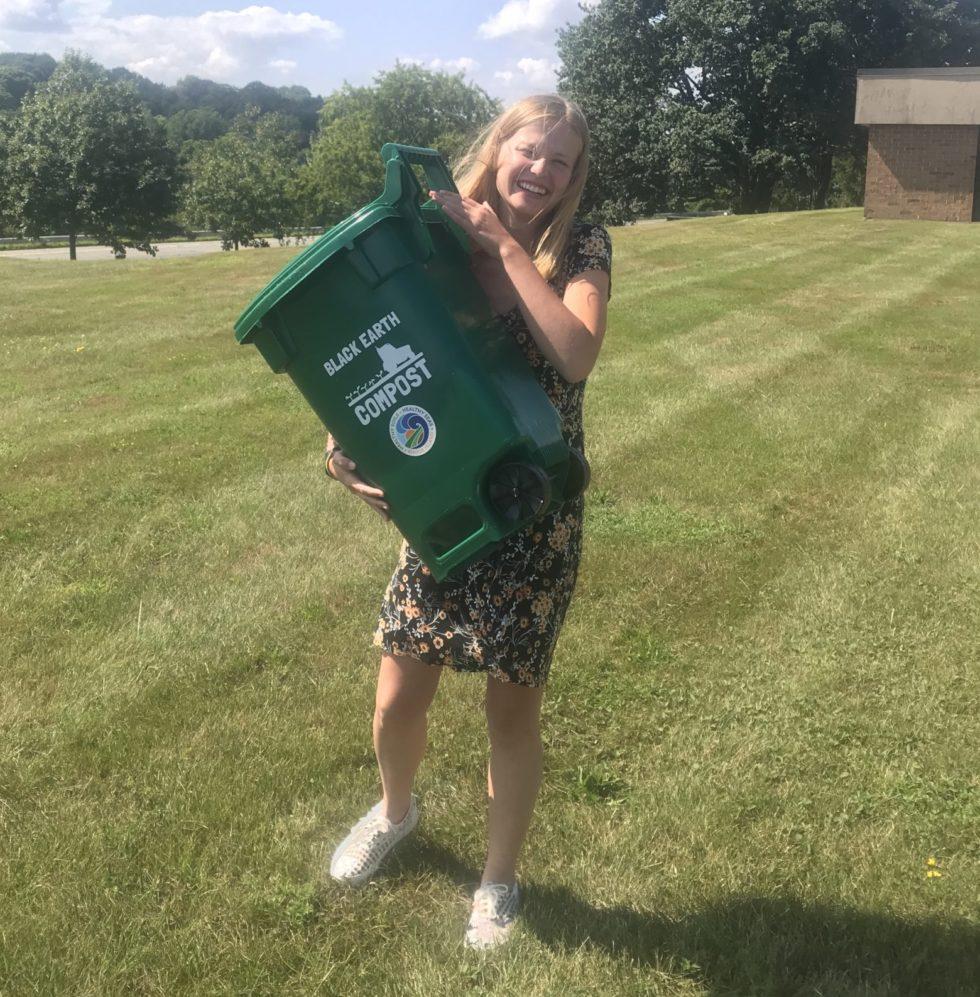 Intern Mathilde holding a Black Earth Compost bin